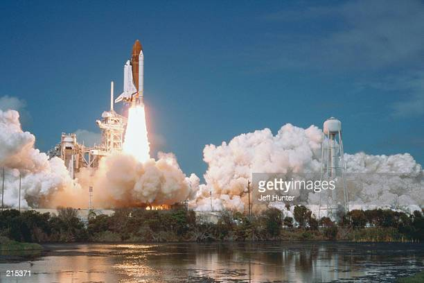 SPACE SHUTTLE BLASTING OFF