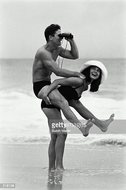 COUPLE ROMPING IN SEA  IN ST. BARTHELEMY IN BLACK AND WHITE