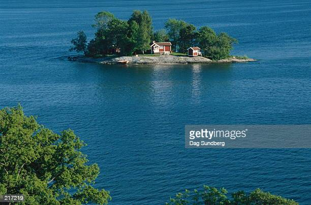 SMALL ISLAND WITH HOUSE IN LIDINGO, SWEDEN
