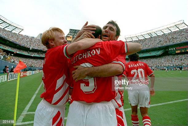 HRISTO STOITCHKOV OF BULGARIA CELEBRATES WITH IORDAN LETCHKOV # 9 MIDDLE AND ILIAN KIRIAKOV LEFT AFTER DEFEATING GERMANY IN THE 1994 WORLD CUP...