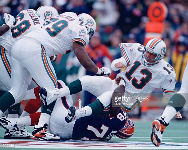 DEFENSIVE END BRUCE SMITH OF THE BUFFALO BILLS DRAGS DOWN QUARTERBACK DAN MARINO OF THE MIAMI DOLPHINS IN THE FIRST HALF OF THE BILLS GAME VERSUS THE...