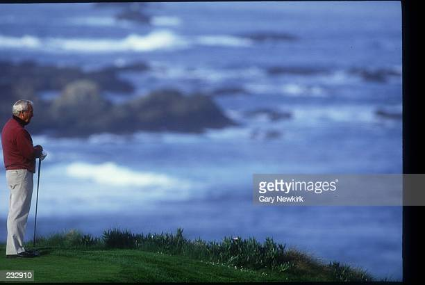 ARNOLD PALMER TAKES A MOMENT TO ENJOY THE SCENERY WHILE WAITING TO TEE OFF ON THE 4TH HOLE AT SPYGLASS GOLF COURSE DURING THE ATT PEBBLE BEACH...