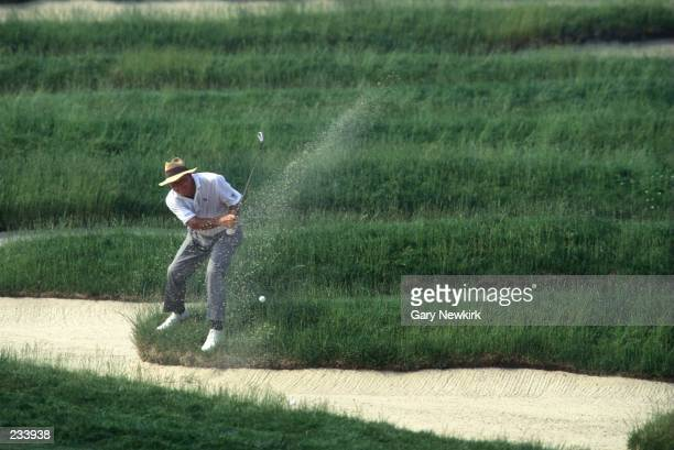 DURING 2ND ROUND ACTION ARNOLD PALMER HITS HIS SECOND SHOT FROM THE INFAMOUS 'CHURCH PEWS' BUNKER ON THE 3RD HOLE DURING THE US OPEN CHAMPIONSHIP AT...