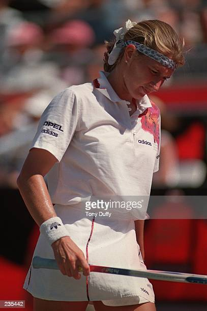 A DEJECTED AND OUTPLAYED STEFFI GRAF EXAMINES HER RACKET AS SHE RETURNS TO THE SERVICE LINE DURING THE TIE BREAKER OF HER MATCH WITH AMANDA COETZER...