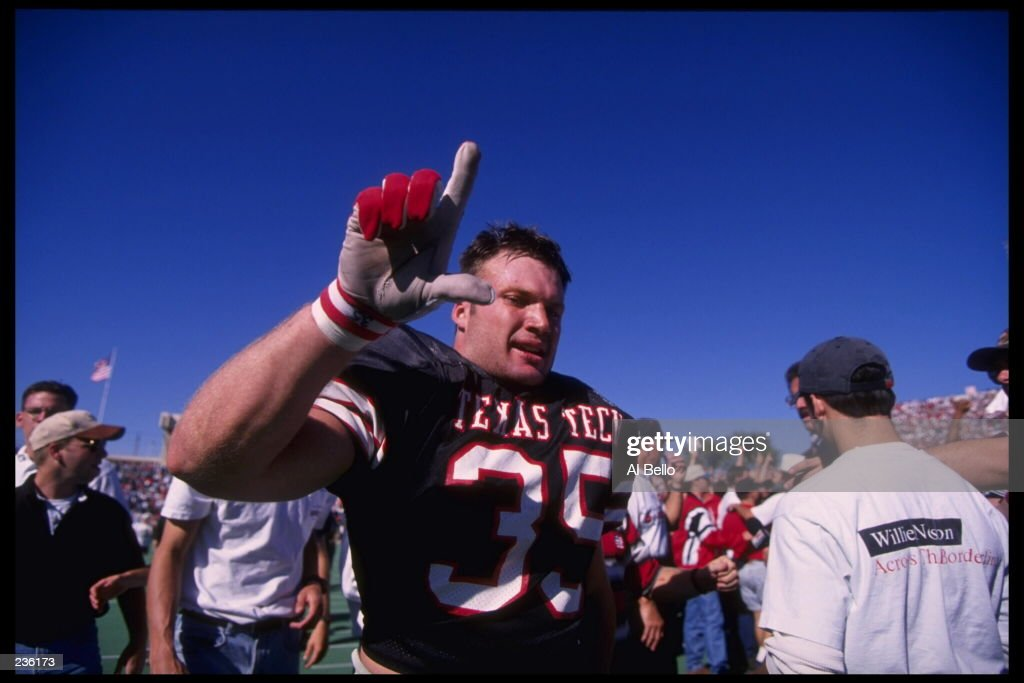 TEXAS TECH LINEBACKER ZACH THOMAS CELEBRATES AFTER INTERCEPTING A PASS AND SCORING THE WINNING TOUCHDOWN DURING THE RED RAIDERS 14-7 WIN OVER TEXAS A&M AT JONES STADIUM IN LUBBOCK, TEXAS.