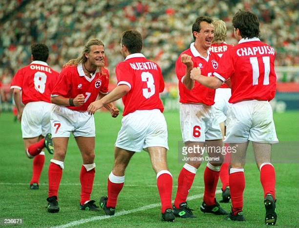 STEPHANE CHAPUISAT OF SWITZERLAND CELEBRATES WITH TEAMMATES AFTER SCORING THE SECOND GOAL DURING A 41 VICTORY AGAINST ROMANIA AT THE SILVERDOME IN...