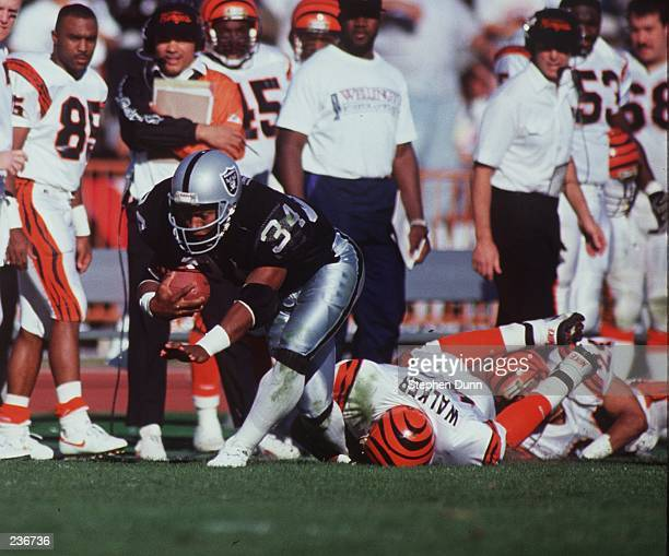 LOS ANGELES RAIDER RUNNING BACK BO JACKSON FALLS TO THE GROUND WITH HIS HIP AT AN AWKWARD ANGLE WHILE BEING TACKLED DURING THE RAIDERS 2010 PLAYOFF...