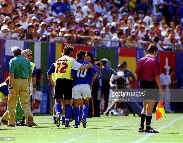 ROBERTO BAGGIO OF ITALY IS LED OFF THE FIELD AFTER BEING SUBSTITUTED DURING THE FIRST HALF AGAINST NORWAY IN THE 1994 WORLD CUP. BAGGIO CAME OFF TO...