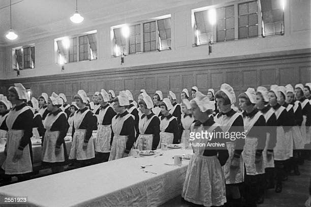 Girls line up for a meal at a London foundling hospital 3rd May 1941 Picture Post 444 Foundling Hospital pub 1941