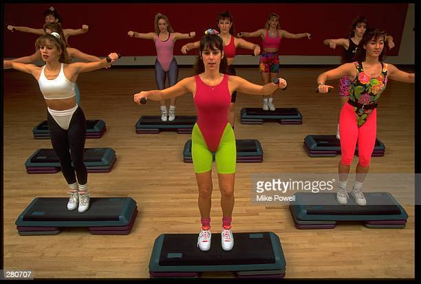 A GROUP OF MODEL RELEASED WOMEN PERFORM A STEP AEROBICS WORKOUT MANDATORY CREDIT MIKE POWELL/ALLSPORT