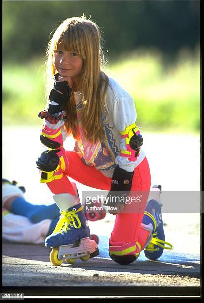 A MODEL RELEASED GIRL STOPS FOR A PICTURE DURING A LONG DAY OF INLINE SKATING