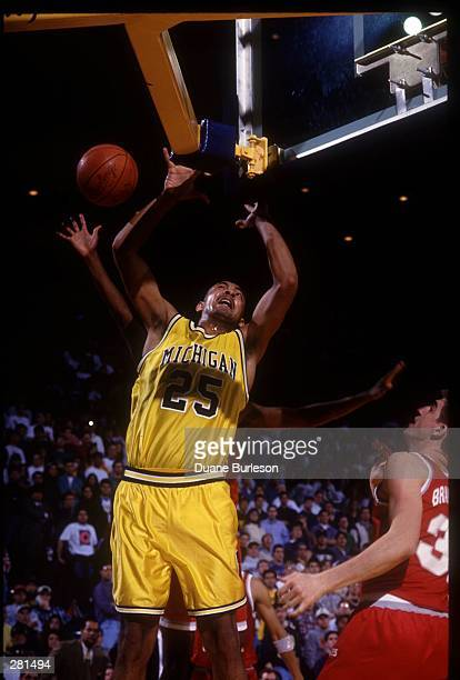 MICHIGAN WOLVERINES CENTER JUWAN HOWARD JUMPS FOR A REBOUND DURING A BIG10 CONFERENCE GAME WITH THE OHIO STATE BUCKEYES
