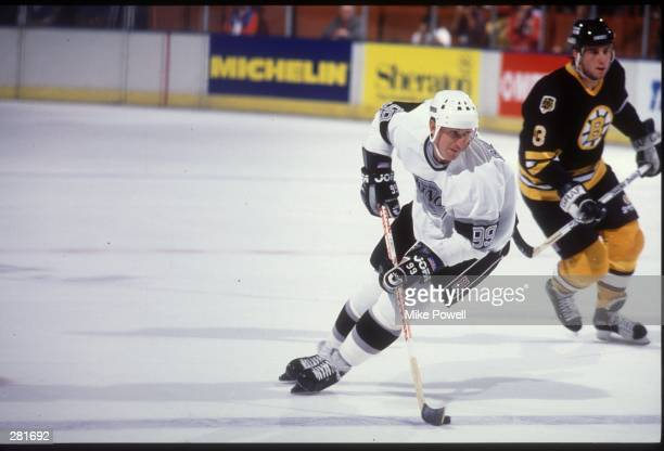 DURING THE 1989 SEASON WAYNE GRETZKY OF THE LOS ANGELES KINGS SKATES WITH THE PUCK AGAINST THE BOSTON BRUINS