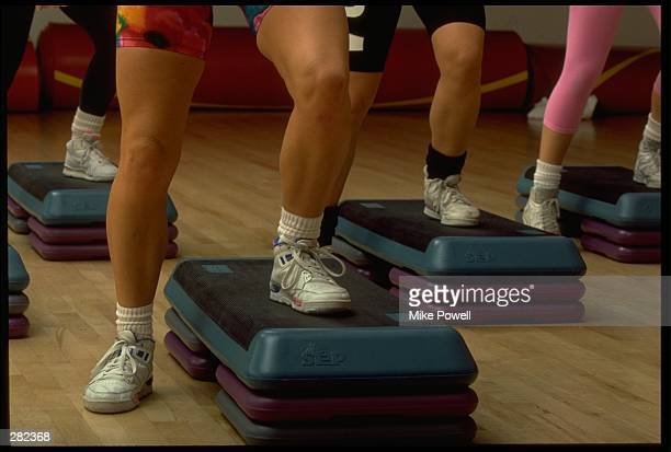 A GROUP OF MODEL RELEASED WOMEN PERFORM A STEP AREOBICS WORKOUT MANDATORY CREDIT MIKE POWELL/ALLSPORT