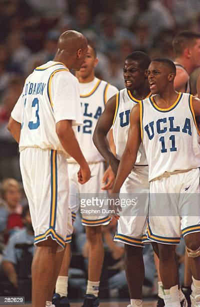 UCLA PLAYERS TYUS EDNEY AND CAMERON DOLLAR CONGRATULATE CHARLES O''BANNON DURING THE FIRST HALF OF THEIR NCAA FINAL FOUR GAME VERSUS OKLAHOMA STATE...
