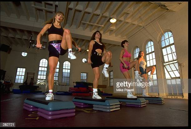 FOUR MODEL RELEASED WOMEN WORKOUT DURING A STEP AEROBICS CLASS MANDATORY CREDIT MIKE POWELL/ALLSPORT