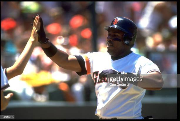 SAN FRANCISCO GIANTS OUTFIELDER KEVIN MITCHELL RECEIVES WELCOME AT HOME PLATE AFTER SCORING IN GIANTS GAME AT CANDLESTICK PARK IN SAN FRANCISCO,...