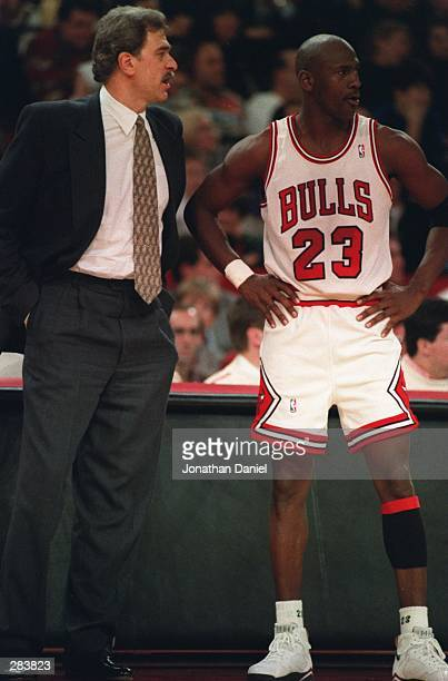 CHICAGO BULLS HEAD COACH PHIL JACKSON AND GUARD MICHAEL JORDAN DISCUSS THEIR GAME AGAINST THE CHARLOTTE HORNETS AT CHICAGO STADIUM IN CHICAGO ILLINOIS