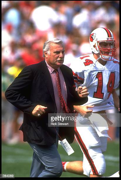 UNIVERSITY OF LOUISVILLE HEAD COACH HOWARD SCHNELLENBERGER RUNS OFF THE FIELD DURING THE CARDINALS 2315 LOSS TO THE OHIO STATE BUCKEYES AT OHIO...