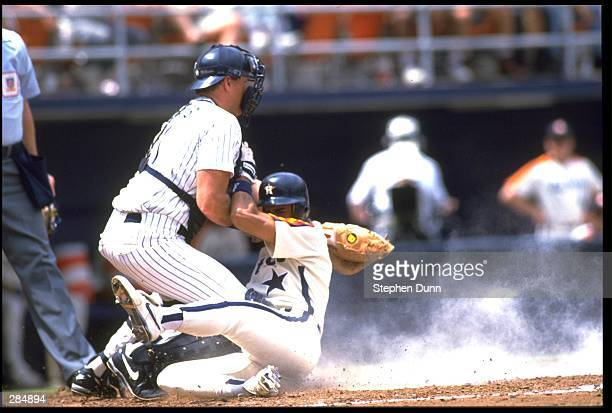 SAN DIEGO PADRES CATCHER DAN WALTERS TAGS OUT HOUSTON ASTROS RUNNER ANDUJAR CEDENO AT JACK MURPHY STADIUM IN SAN DIEGO CALIFORNIA MANDATORY CREDIT...