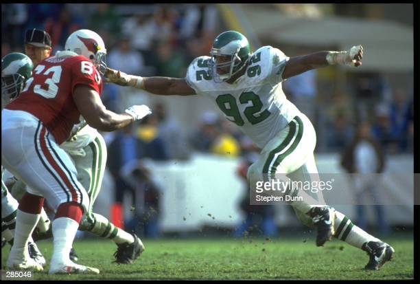 PHILADELPHIA EAGLES DEFENSIVE END REGGIE WHITE ATTEMPTS TO BREAK THROUGH THE PHOENIX CARDINALS OFFENSIVE LINE DURING THE EAGLES 23-21 VICTORY OVER...