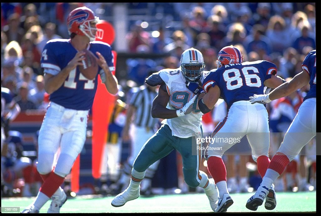 MIAMI DOLPHINS DEFENSIVE LINEMAN MARCO COLEMAN, #90, RUSHES HARD ...