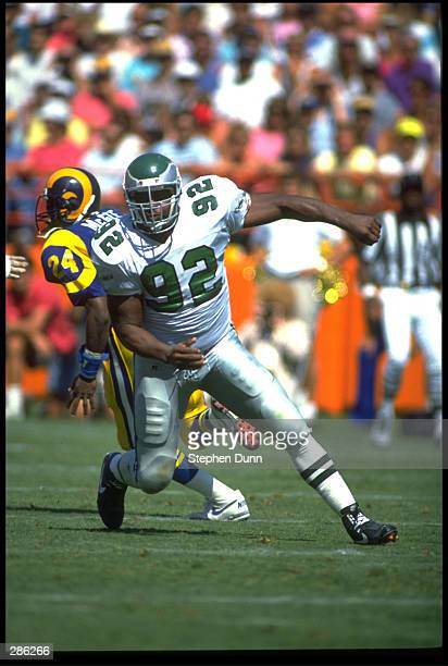PHILADELPHIA EAGLES DEFENSIVE END REGGIE WHITE IS IN PURSUIT OF THE LOS ANGELES RAMS QUARTERBACK DURING THE EAGLES 2721 VICTORY OVER THE RAMS AT...
