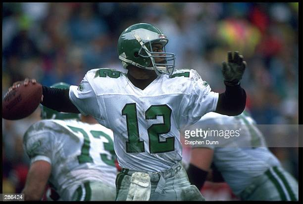 PHILADELPHIA EAGLES QUARTERBACK RANDALL CUNNINGHAM LOOKS TO PASS DOWNFIELD DURING THE EAGLES 23-21 VICTORY OVER THE PHOENIX CARDINALS AT SUN DEVIL...