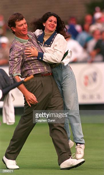 A VICTORIOUS PETER JACOBSEN CARRIES HIS WIFE JAN OFF TOWARDS THE GREENSIDE POND AFTER SINKING HIS FINAL PUTT ON THE 18TH GREEN DURING THE FINAL ROUND...