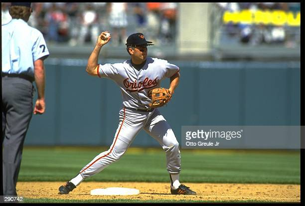 BALTIMORE ORIOLES SHORTSTOP CAL RIPKEN JR. ATTEMPTS TO TURN A DOUBLE PLAY DURING THE ORIOLES VERSUS OAKLAND ATHLETICS GAME AT THE OAKLAND COLISEUM IN...