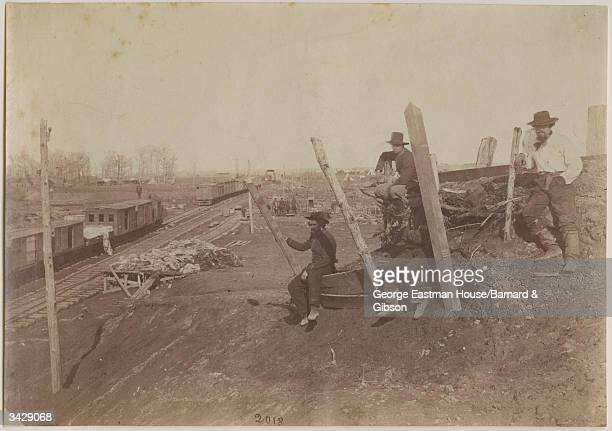 Confederate troops making camp at the Manassas Junction railroad station Virginia the site of two famous battles of the American Civil War known as...