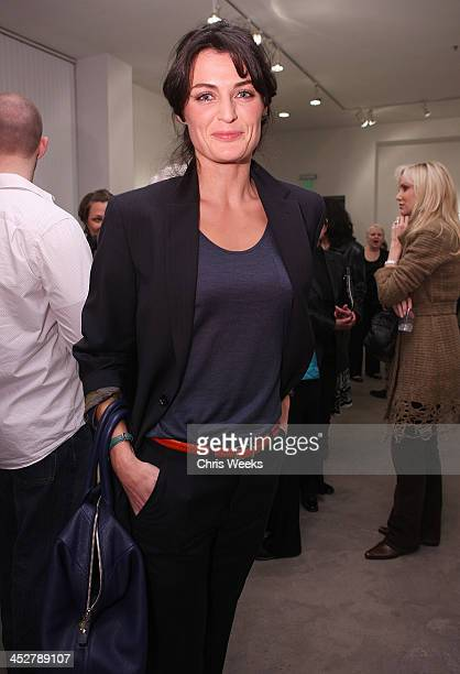 Actress Lyne Renee attends the private preview of Robert Graham's Last Works at Ace Gallery on April 16, 2009 in Los Angeles, California.