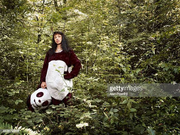 WOMAN DRESSED AS PANDA IN FOREST