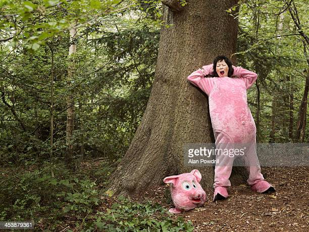 woman dressed as pig in forest - yawning stock pictures, royalty-free photos & images