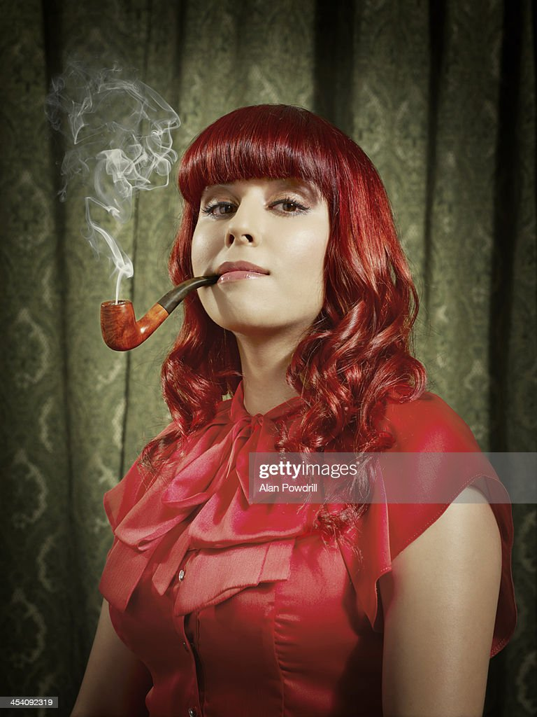PORTRAIT OF WOMAN SMOKING PIPE