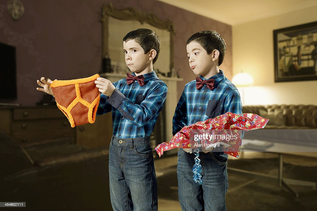 TWINS HOLDING Y-FRONTS GIFT : Stock Photo