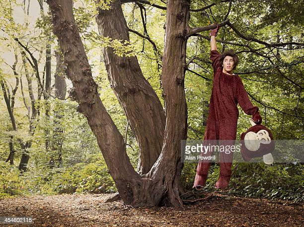 man dressed as monkey in tree - animal costume stock pictures, royalty-free photos & images