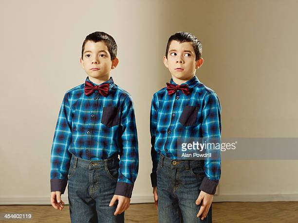 portrait of young twin boys in bow ties - twin stock pictures, royalty-free photos & images