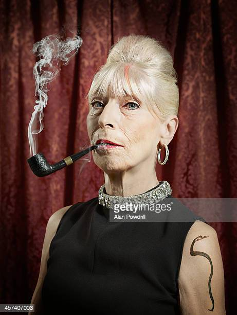 portrait of woman smoking a pipe - black snake stock pictures, royalty-free photos & images