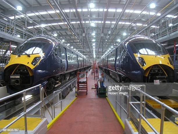CONTENT] Class 395 highspeed commuter trains sit side by side in the Ashford Kent depot operated by Japan's Hitachi the train's builder The trains...