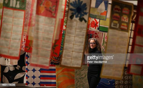 Pae White stands amongst her collection of Vera Newman scarves at the Magnificent Obsessions The Artist as Collector exhibition at the Barbican Art...