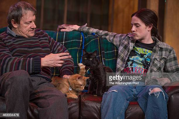 Mark Lee Adams playing Donny in The Lieutenant of Inishmore left takes a break with Chris Dinolfo playing Davey and the cats OJ and Moose during a...