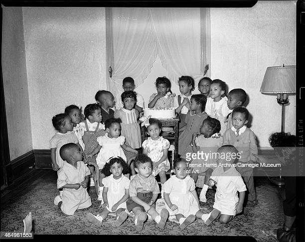 Group portrait of birthday party including Marian Baker John Baker Patricia Cathie Quintella Cathie Barbara Ficklin Audrey Ficklin Helene Fisher...