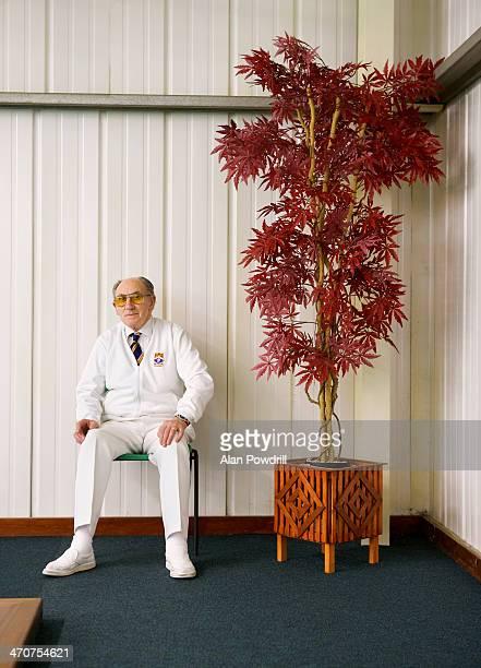 ELDERLY BOWLER IN WHITE SITTING