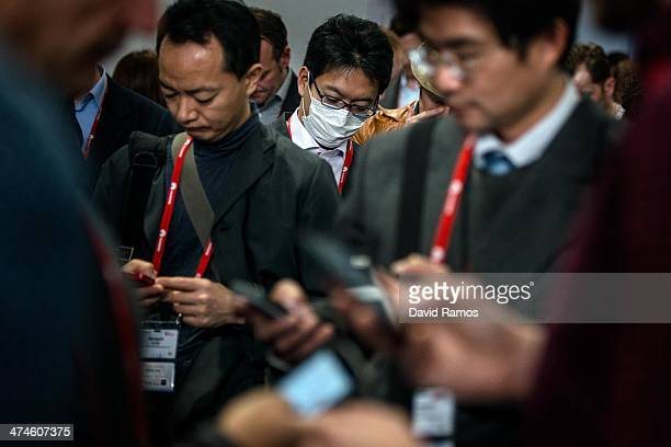 Visitors stand on a queue for the Whatsapp CEO Jan Koum during the first day of the Mobile World Congress 2014 at the Fira Gran Via complex on...