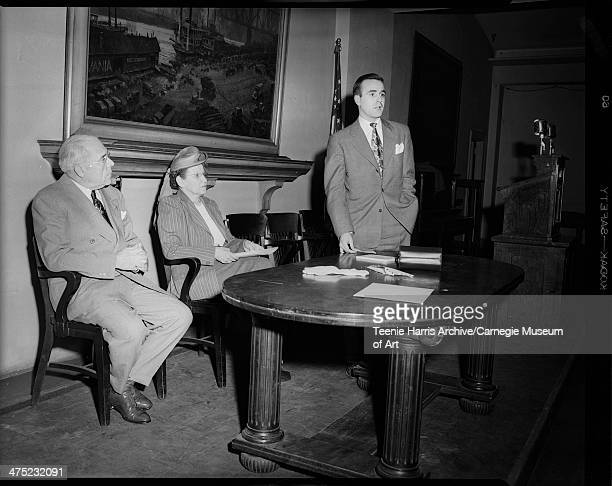 Pittsburgh Mayor David L Lawrence and Jessie Vann seated on left as promotion manager of radio station WCAE William Kelly speaks about 'America's...