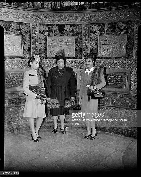 Helen Stout Sally Jackson and Doris Harper posed in front of Westinghouse Monument Schenley Park Pittsburgh Pennsylvania March April 1946
