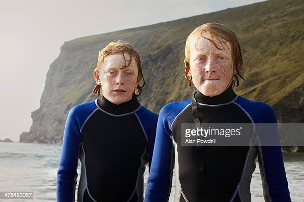 TWO RED HAIRED YOUNG SURFER BROTHERS