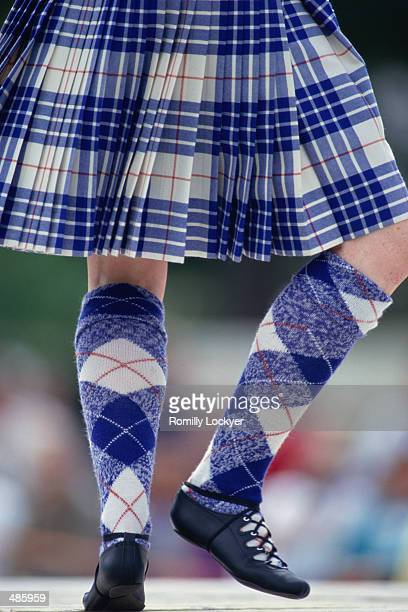 highland dancer's legs & kilt in scotland - scottish culture stock pictures, royalty-free photos & images