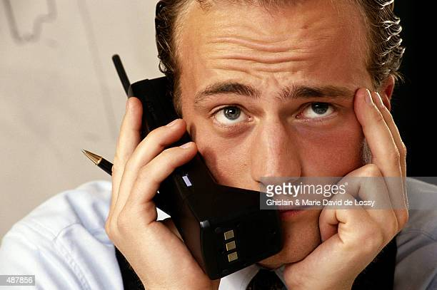 CLOSE-UP OF A BUSINESSMAN ON PHONE